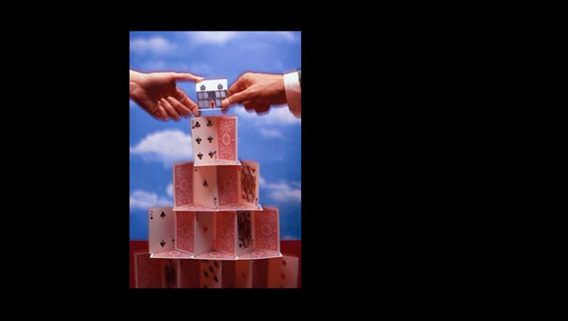 Een dia met een afbeelding van een kaartenhuis